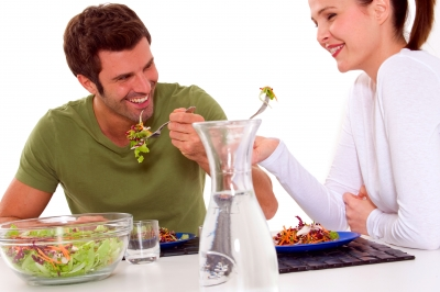 husband and wife eating salad