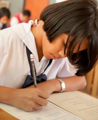 schoolgirl taking exam
